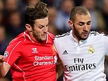 Liverpool's Adam Lallana (left) and Real Madrid's Karim Benzema battle for the ball during the UEFA Champions League Group B match at the Santiago Bernabeu, Madrid, Spain. PRESS ASSOCIATION Photo. Picture date: Tuesday November 4, 2014. See PA story SOCCER Madrid. Photo credit should read Adam Davy/PA Wire.