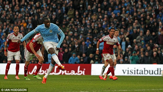 Composed: Toure slots his first penalty away at the Etihad Stadium