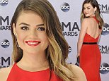 Lucy Hale arrives at the 48th annual CMA Awards at the Bridgestone Arena on Wednesday, Nov. 5, 2014, in Nashville, Tenn. (Photo by Evan Agostini/Invision/AP)