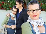 Beverly Hills, CA - Pregnant couple Milla Jovovich and Paul W. S. Anderson take a happy stroll in Beverly Hills after lunch at Il Pastaio. Milla went braless in a grey tank with a green sweater and scarf with denim jeans and sandals as she stepped out with her man for a lunch for three.\nAKM-GSI       November  5, 2014   \nTo License These Photos, Please Contact :\nSteve Ginsburg\n(310) 505-8447\n(323) 423-9397\nsteve@akmgsi.com\nsales@akmgsi.com\nor\nMaria Buda\n(917) 242-1505\nmbuda@akmgsi.com\nginsburgspalyinc@gmail.com