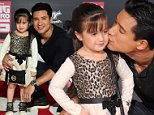 Mario Lopez kisses his daughter Gia on arrival for the premiere of Disney's 'Big Hero 6' in Hollywood, California on November 4, 2014. The film opens in theaters nationwide on November 7. AFP PHOTO/Frederic J. BROWNFREDERIC J. BROWN/AFP/Getty Images