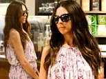 Glowing Terri Seymour shows a hint of baby belly in a maxi dress as she steps out for a coffee at Starbucks in Beverly Hills, CA.\n\nPictured: Terri Seymour\nRef: SPL883492  051114  \nPicture by: Splash News\n\nSplash News and Pictures\nLos Angeles: 310-821-2666\nNew York: 212-619-2666\nLondon: 870-934-2666\nphotodesk@splashnews.com\n