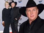 Trisha Yearwood, left, and Garth Brooks arrive at the 48th annual CMA Awards at the Bridgestone Arena on Wednesday, Nov. 5, 2014, in Nashville, Tenn. (Photo by Evan Agostini/Invision/AP)