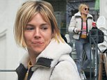Actress Sienna Miller wearing a white fur jacket, multicolored jumper, grey skinny jeans and Dunlop trainers, spotted having a coffee outside a cafe in Primrose Hill with fashion designer Matthew Williamson.  London, UK. 05/11/2014\nBYLINE MUST READ : GOTCHAIMAGES.COM\nCopyright by © Gotcha Images Ltd. All rights reserved.\nUsage of this image is conditional upon the acceptance \nof Gotcha Images Ltd, terms and conditions available at\nwww.gotchaimages.com