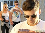 UK CLIENTS MUST CREDIT: AKM-GSI ONLY..West Hollywood, CA - Zac Efron and his girlfriend Sami Miro spend the day together out in West Hollywood.  Zac showed support for Sami and accompanied her to a modeling agency.  The couple walked back to the car and had some laughs along the way.....Pictured: Zac Efron and Sami Miro..Ref: SPL883379  051114  ..Picture by: AKM-GSI / Splash News....