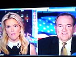 Megyn Kelly mike huckababee grab 02.jpg