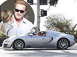 Please contact X17 before any use of these exclusive photos - x17@x17agency.com   EXCLUSIVE - Arnold Schwarzenegger and Heather Milligan enjoyed a ride in his $2.25 million Bugatti Veyron, cruising through Santa Monica, on November 10, 2014 X17online.com