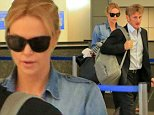 Sean Penn and Charlize Theron returned to Los Angles from Paris, France.  Sean was dressed in a sharp suit, while Charlize went casual.  Monday, November 10, 2014 X17online.com