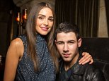 LOS ANGELES, CA - NOVEMBER 10:  (EXCLUSIVE COVERAGE)  Olivia Culpo (L) and musician Nick Jonas attend Flaunt Magazine, Hollywood Roosevelt Hotel, and William Henry Release The Grind Issue Featuring Nick Jonas Album Release Performance on November 10, 2014 in Los Angeles, California.  (Photo by Chelsea Lauren/Getty Images)