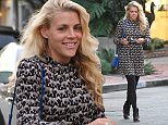 Busy Philipps was spotted at the Beverly Center mall, looking good in a black and white dress, with tights and a blue handbag.  The blonde actress and mother of two had her hair down, with minimal makeup, on November 10, 2014 X17online.com