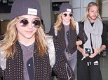 ©2014 RAMEY PHOTO 310-828-3445\nLOS ANGELES\nCHLOE GRACE MORETZ AND  BROTHER AT LAX.\n111014\nPRB12