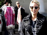 Picture Shows: Dianna Agron  November 10, 2014\n \n 'Glee' star Dianna Agron stops to pick up several unique costumes from a dry cleaner in Studio City, California.\n \n Exclusive All Rounder\n UK RIGHTS ONLY\n Pictures by : FameFlynet UK © 2014\n Tel : +44 (0)20 3551 5049\n Email : info@fameflynet.uk.com