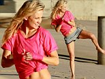 128890, EXCLUSIVE: Kate Hudson shows off her karate skills during a beach photo shoot for her brand Fabletics in Malibu. The 'Wish I was Here' star rocked gray workout shorts with a hot pink top and matching wrist wraps as she performed an air kick in the sand. Malibu, California - Monday November 10, 2014. Photograph: KVS/Pedro Andrade, © PacificCoastNews. Los Angeles Office: +1 310.822.0419 sales@pacificcoastnews.com FEE MUST BE AGREED PRIOR TO USAGE