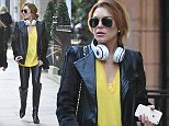EXCLUSIVE: Lindsey Lohan Spotted strolling through Mayfair with friends on Sunday. Lindsay was carrying a strange doll while wearing Beats by Dre.\n\nPictured: Lindsey Lohan\nRef: SPL886630  101114   EXCLUSIVE\nPicture by:Splash News BR\n\nSplash News and Pictures\nLos Angeles: 310-821-2666\nNew York: 212-619-2666\nLondon: 870-934-2666\nphotodesk@splashnews.com\n
