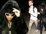 Nicki Minaj was spotted at LAX, back in LA after hosting and winning big at the MTV European Music Awards.  The star was wearing a huge black fur coat, with shades, on November 10, 2014 X17online.com