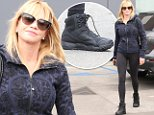 Melanie Griffith was spotted at lunch in Beverly Hills.  The star was wearing a cool designer hoodie, with yoga tights and black trainers, on November 11, 2014  X17online.com