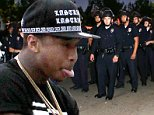 Tyga was out on Melrose Boulevard, shooting his music video without a permit for the second day in a row.  Yesterday he got handcuffed; today, the cops busted out their riot helmets to break up the crowd. November 11, 2014  X17online.com