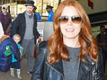 12.NOVEMBER.2014 - LOS ANGELES - USA  AMY ADAMS AND HUSBAND DARREN LE GALLO RETURN TO LOS ANGELES WITH DAUGHTER AVIANA ON AN INCOMING FLIGHT AT LOS ANGELES INTERNATIONAL AIRPORT ( LAX ). THE LOVELY RED HEADED ACTRESS SMILED FOR THE CAMERAS IN A BLACK LEATHER JACKET, BLUE DENIM SKINNIES AND GREY LEATHER HEELED BOOTIES FOR HER RETURN TO THE CITY OF ANGELS. BYLINE MUST READ : XPOSUREPHOTOS.COM *AVAILABLE FOR UK SALE ONLY* ***UK CLIENTS - PICTURES CONTAINING CHILDREN PLEASE PIXELATE FACE PRIOR TO PUBLICATION *** *UK CLIENTS MUST CALL PRIOR TO TV OR ONLINE USAGE PLEASE TELEPHONE 0208 344 2007*