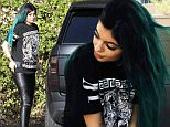 Calabasas, CA - Kylie Jenner undergoes a wardrobe change after attending her sister, Kourtney Kardashian's baby shower earlier today in Beverly Hills.  Kylie changed into a shirt from her rumored boyfriend, Tyga's clothing line, Last Kings, and paired it with black leather pants and boots.  It looks like the young reality star also re-dyed her hair to a green ombre. AKM-GSI          November 12, 2014 To License These Photos, Please Contact : Steve Ginsburg (310) 505-8447 (323) 423-9397 steve@akmgsi.com sales@akmgsi.com or Maria Buda (917) 242-1505 mbuda@akmgsi.com ginsburgspalyinc@gmail.com