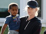 @NATIONAL PHOTO GROUP\nCharlize Theron picks up her son Jackson Theron from school on Wednesday in Los Angeles.\nJob: 111314X1\nEXCLUSIVE  November 12, 2014  Los Angeles, CA..NPG.com