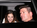 129006, EXCLUSIVE: Robin Thicke leaves with a mysterious girl after attending Leonardo DiCaprio's birthday party at Soho House in Los Angeles. Los Angeles, California - Tuesday NOvember 11, 2014. Photograph: © Devone Byrd, PacificCoastNews. Los Angeles Office: +1 310.822.0419 sales@pacificcoastnews.com FEE MUST BE AGREED PRIOR TO USAGE