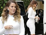 129021, Kim and Khloe Kardashian and Kylie Jenner seen filming their reality show at The Montage in Beverly Hills. Khloe Kardashian shows off her figure in a snug all white ensemble of a crop top and midi skirt along with a matching white Chanel purse. Los Angeles, California - Wednesday November 12, 2014. Photograph: Juan Sharma/Bruja, © PacificCoastNews. Los Angeles Office: +1 310.822.0419 sales@pacificcoastnews.com FEE MUST BE AGREED PRIOR TO USAGE