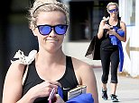 UK CLIENTS MUST CREDIT: AKM-GSI ONLY EXCLUSIVE: Reese Witherspoon finishes up her workout in Santa Monica and gets in a little shopping afterwards as she walks to her car with a shopping bag in tow. The actress had her hands full carrying her cell phone, wallet, car keys and a sweater.  Pictured: Reese Witherspoon Ref: SPL888020  111114   EXCLUSIVE Picture by: AKM-GSI / Splash News