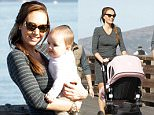 EXCLUSIVE ALL ROUND PICTURE: COLEMAN-RAYNER / MATRIXPICTURES.CO.UK\nPLEASE CREDIT ALL USES\nUK RIGHTS ONLY\nBritish socialite Tamara Ecclestone is pictured with her baby daughter Sophia on a sightseeing tour in San Francisco, California. \nTamara mingled with other tourists and was joined by her brand manager and good friend Scott Harvey-Nicholls who took photographs of Tamara and Sophia in front of attractions such as the Golden Gate Bridge and Alcatraz. \nBaby Sophia, who was named after Tamara's style icon Sophia Loren, giggled and looked happy during her day out.\nTamara looks chic in a simple stripe jersey dress and suede boots.\nNOVEMBER 15th 2014\nREF: CRM 144819