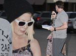 EXCLUSIVE: Tori Spelling and Dean McDermott spend over 4 hours at their usual massage establishment on a Saturday afternoon in Los Angeles. As they exited, it became noticeable that Tori had some strange red markings on her upper lip. \n\nPictured: Tori Spelling, Dean McDermott\nRef: SPL888835  151114   EXCLUSIVE\nPicture by: MAP  / Splash News\n\nSplash News and Pictures\nLos Angeles: 310-821-2666\nNew York: 212-619-2666\nLondon: 870-934-2666\nphotodesk@splashnews.com\n