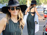 Picture Shows: Nikki Reed  November 15, 2014\n \n 'Twilight' actress Nikki Reed out shopping at Fred Segal in West Hollywood, California. Nikki was looking stylish in a black wide brim hat, striped maxi dress and black ankle boots.\n \n Non Exclusive\n UK RIGHTS ONLY \n \n Pictures by : FameFlynet UK © 2014\n Tel : +44 (0)20 3551 5049\n Email : info@fameflynet.uk.com