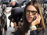 Alessandra Ambrosio gets a flat tire and requires the help of a worker at the gas station.\n\nPictured: Alessandra Ambrosio \nRef: SPL890643  151114  \nPicture by: T.Maidana / Splash News\n\nSplash News and Pictures\nLos Angeles: 310-821-2666\nNew York: 212-619-2666\nLondon: 870-934-2666\nphotodesk@splashnews.com\n