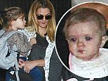 Drew Barrymore and husband Will Kopelman with their two daughters Frankie and Olive  arrive at LAX on November 15, 2014  X17online.com