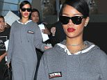 Picture Shows: Rihanna  November 14, 2014\n \n Singer Rihanna arriving on a flight at LAX airport in Los Angeles, California on November 14, 2014. Rihanna was wearing a hooded grey DKNY dress and a pair of funny looking black sneakers.\n \n Non-Exclusive\n UK RIGHTS ONLY\n \n Pictures by : FameFlynet UK © 2014\n Tel : +44 (0)20 3551 5049\n Email : info@fameflynet.uk.com
