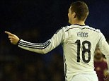 Germany's midfielder Toni Kroos celebrates after scoring during a friendly football match Spain vs Germany at the Balaidos stadium in Vigo on November 18, 2014.   AFP PHOTO / JAVIER SORIANOJAVIER SORIANO/AFP/Getty Images