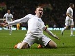 England's striker Wayne Rooney celebrates scoring their second goal during the international friendly football match between Scotland and England at Celtic Park in Glasgow, Scotland, on November 18, 2014. AFP PHOTO / IAN MACNICOLIan MacNicol/AFP/Getty Images