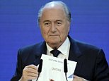 (FILES) A file picture taken on December 2, 2010 shows FIFA President Sepp Blatter holding up the name of Qatar during the official announcement of the 2022 World Cup host country at the FIFA headquarters  in Zurich. Football's world governing body FIFA has cleared on November 13, 2014 the 2022 World Cup hosts Qatar of corruption and ruled out a re-vote to decide the host of the competition despite widespread allegations of wrongdoing. AFP PHOTO / PHILIPPE DESMAZESPHILIPPE DESMAZES/AFP/Getty Images