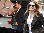 geri halliwell engaged  to Christian Horner return to Heathrow yesterday