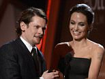 "Director Angelina Jolie presents the New Hollywood Award to Jack O'Connell for their film ""Unbroken"" during the Hollywood Film Awards in Hollywood, California November 14, 2014.   REUTERS/Kevork Djansezian (UNITED STATES  - Tags: ENTERTAINMENT)"