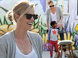 Picture Shows: Charlize Theron, Jackson Theron  November 17, 2014\n \n 'Monster' actress Charlize Theron is spotted picking up her adorable son Jackson from school in Los Angeles, California. \n \n Jackson looked happy as his mum collected him and waved his 'Frozen' lunchbox.\n \n Exclusive - All Round\n UK RIGHTS ONLY\n \n Pictures by : FameFlynet UK © 2014\n Tel : +44 (0)20 3551 5049\n Email : info@fameflynet.uk.com