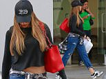 UK CLIENTS MUST CREDIT: AKM-GSI ONLY\nEXCLUSIVE: Sofia Vergara keeps her head down to hide her makeup free face on a casual day of shopping in Beverly Hills. The 'Modern Family' beauty hid her makeup free face from the camera as she walked back to her car following some shopping in the city. Sofia wore distressed denim jeans with white sneakers, a black crop top, and a flannel shirt wrapped around her waist, as she hid under her baseball cap to avoid being noticed.\n\nPictured: Sofia Vergara\nRef: SPL893645  181114   EXCLUSIVE\nPicture by: AKM-GSI / Splash News\n\n
