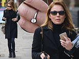 LONDON, UNITED KINGDOM - NOVEMBER 19: (EXCLUSIVE COVERAGE) Newly Engagaed Geri Halliwell displaying her diamond engagement ring as she's pictured in North London on November 19, 2014 in London, England. (Photo by Neil P. Mockford/GC Images)