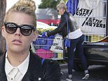 EXCLUSIVE: Busy Philipps loaded up her car after shopping at Whole Foods in West Hollywood,CA\n\nPictured: Busy Philipps \nRef: SPL892620  171114   EXCLUSIVE\nPicture by: Ako/Splash News\n\nSplash News and Pictures\nLos Angeles: 310-821-2666\nNew York: 212-619-2666\nLondon: 870-934-2666\nphotodesk@splashnews.com\n