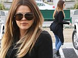 Khloe Kardashian starts her holiday shopping at Crate and Barrel with a friend in Calabasas. November 18, 2014 X17online.com