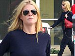 UK CLIENTS MUST CREDIT: AKM-GSI ONLY EXCLUSIVE: Santa Monica, CA - Actress Gwyneth Paltrow gets her week started on the right foot and heads to a local office for a casual meeting.  Gwyneth had a comfy cool look today with a long sleeve navy tee and matching tuxedo pants to go with her grey slip-ons while the wind blew through her hair.  The 42 year old mother of two was recently featured in Max Factor's 100 Years of Glamour photo series, channeling the late Marilyn Monroe.  Pictured: Gwyneth Paltrow Ref: SPL892812  171114   EXCLUSIVE Picture by: AKM-GSI
