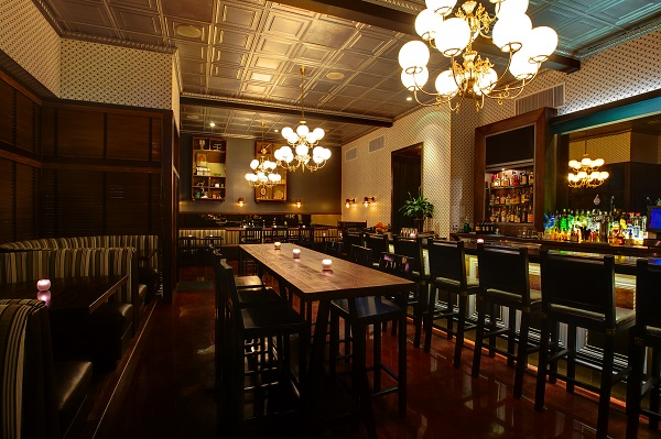 """Sip, savor and celebrate in our private Prohibition-style """"Parlour,"""" a low-lit lounge with its own beautiful bar and available separate entrance. This space accomodates up to 50 seated and 100 standing, with room for mingling or dancing"""