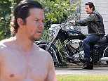 """Picture Shows: Mark Wahlberg  November 17, 2014    Stars on set film a scene on the first day of shooting 'Daddy's Home', in New Orleans, Louisiana. Before filming, Mark Wahlberg was tossing a football around the set, but he was all business once cameras started to roll. He sat on an Indian Motorcycle for one scene and got out of a wrecked minivan with Will Ferrell, arriving home to kids yelling """"Daddy's home!"""" The duo of Wahlberg and Ferrell are reuniting on screen for the first time since their hit 'The Other Guys.'     Exclusive All Rounder  UK RIGHTS ONLY  Pictures by : FameFlynet UK    2014  Tel : +44 (0)20 3551 5049  Email : info@fameflynet.uk.com"""