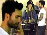 UK CLIENTS MUST CREDIT: AKM-GSI ONLY\nEXCLUSIVE: Adam Levine joined his wife Behati Prinsloo and Maroon 5 bandmates for a smoke break backstage after the band's performance at A Very Grammy Christmas in Los Angeles. The loving couple shared a kiss while band members unwound after the show.\n\nPictured: Adam Levine and Behati Prinsloo\nRef: SPL894058  181114   EXCLUSIVE\nPicture by: AKM-GSI / Splash News\n\n