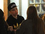 Brooklyn Beckham is seen with a group of girls at winter wonderland, brooklyn chatted to his friends who were all drinking pints of lager the group were spotted at the bar. 20 November 2014. Please byline: Vantagenews.co.uk