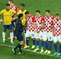 Toeing the line: Croatia players are forced to stay behind the line as Brazil take a free-kick