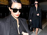 Kim Kardashian dressed to impress at LAX in all black coming back from Dubai. November 25, 2014 X17online.com